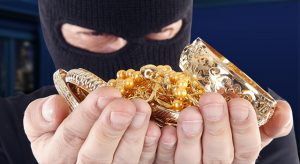 Masked man is holding stolen gold