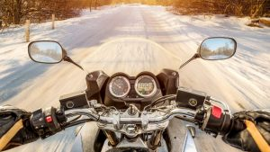 Biker First-person view. Winter slippery road